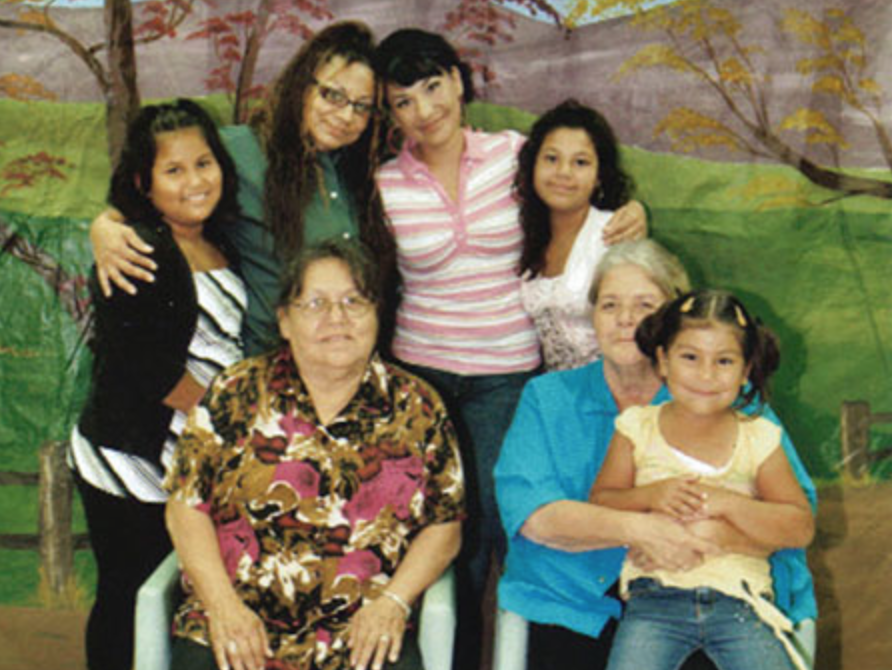 2013: Kylee is the young woman in the white blouse. She is the toddler in the blue outfit from the photo taken in 2000.