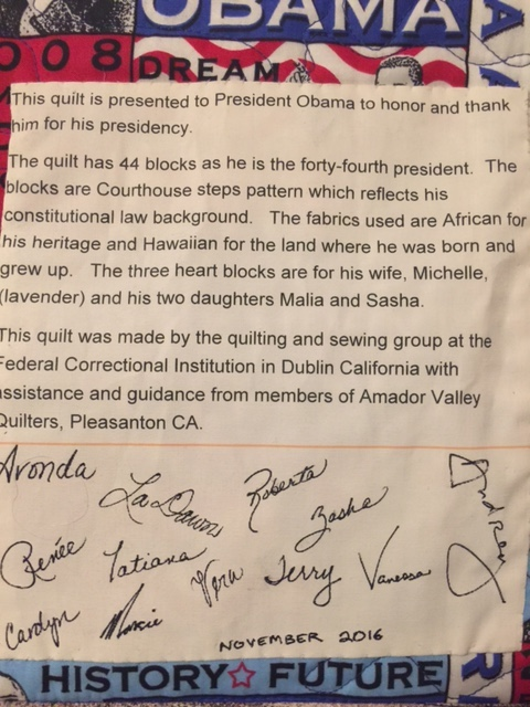 Signature patch of the women who made the quilt and message explaining the design