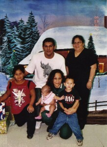 LaVonne holding her grandkids in prison.