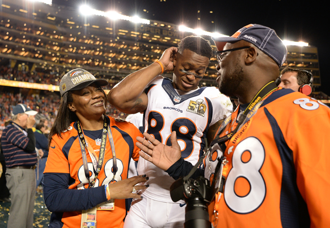 Demaryius Thomas (88) of the Denver Broncos leaves the field with his mom, Katina Smith, and dad, Bobby Thomas, after the game. The Denver Broncos played the Carolina Panthers in Super Bowl 50 at Levi's Stadium in Santa Clara, Calif. on Feb. 7, 2016. (AAron Ontiveroz, The Denver Post)