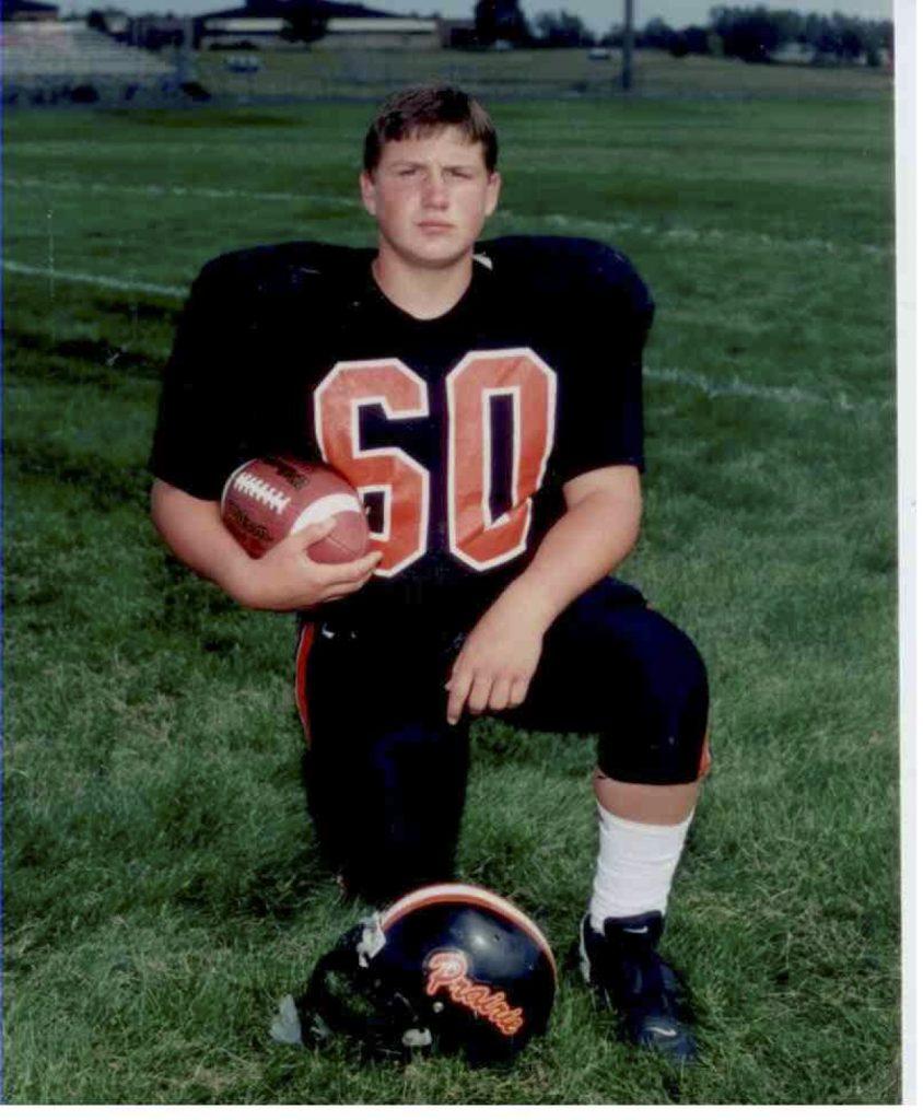 Michael in his high school football uniform